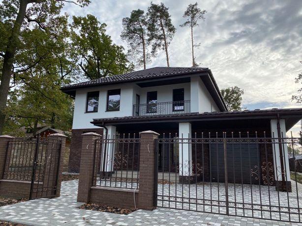 Кирпичный Дом с гаражом на шести сотках в г. Буча