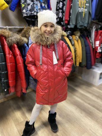 Дитячі куртки пальто комбінезони зима