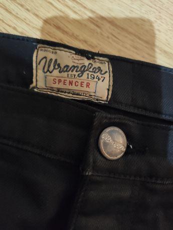 Czarne spodnie jeansowe Spencer Wrangler