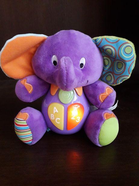 Smily przytulanka edukacyjny słonik, słoń gra i świeci