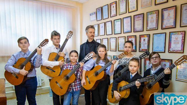 Уроки игры на гитаре в Харьковской ДШИ ,частным образом и дистанционно
