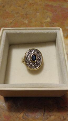 Złoty pierścionek 18K z szafirem i diamencikami