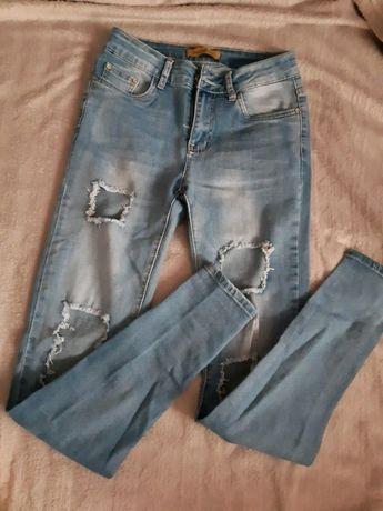 Nowe spodnie jeansy z dziurami 34 XS