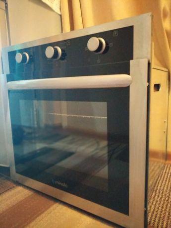 Продам встроенную духовую печь Minola