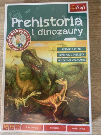 Prehistoria i dinozaury - trefl gra edukacyjna z serii Mali odkrywcy.