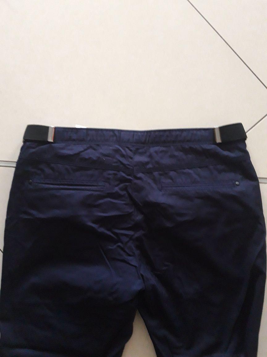 RESERVED eleganckie granatowe spodnie casual Slim fit r. 50