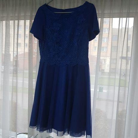 Niebieska sukienka. Cena 50zł